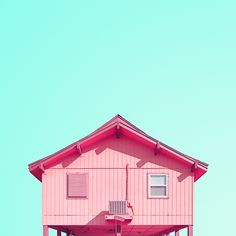 A pink beach house in Galveston, Texas with one shuttered window, giving the impression the house is winking.