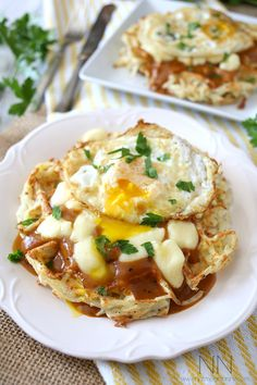 Poutine Hash Brown Waffles: Super crisp hash brown waffles topped with homemade gravy, cheddar cheese curds and a fried egg.