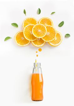 Orange juice in glass bottle with thinking bubbles formed by orange slice