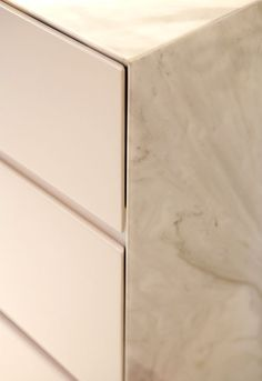 Minimal Marble Kitchen Detail - the delicate marble subtly frames the white kitchen producing a high end, impressive finish