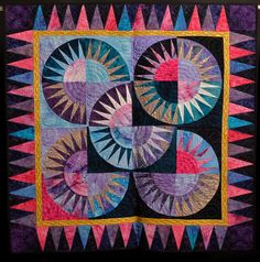 New York Beauty with metallic accents by Rosemary Fisher. Long-arm Quilter: Donald Fritz.  2013 Quilt show, WV Culture