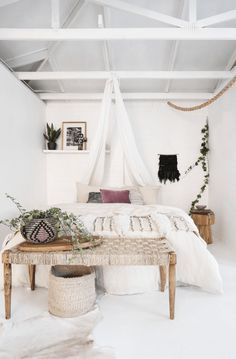 Gorgeous shabby chic bedroom decor idea - complete with weaves, hanging curtains, indoor plants, picture frames and faux fur #bedroom #interior #decor