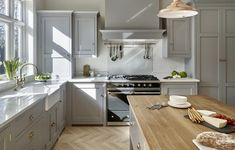Contemporary country kitchen painted in 'Lead' by Little Greene. Oak island worktop, light parquet flooring, butler sink, traditional oven range and shaker style cabinets. Painting Kitchen Cabinets, Kitchen Paint, Home Decor Kitchen, Country Kitchen, Kitchen Interior, New Kitchen, Kitchen Design, Kitchen Tips, Kitchen Island