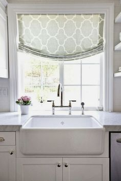 source: Shea McGee Design website Sun filled kitchen features window covered in Windsor Smith Riad Fabric in Seafoam over farmhouse sink accented with polished nickel bridge faucet. - for kitchen sink window New Kitchen, Kitchen Decor, Kitchen White, Rustic Kitchen, Kitchen Ideas, 1960s Kitchen, Long Kitchen, Kitchen Corner, Kitchen Trends