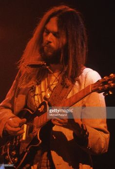 Neil Young performs on stage at the Rainbow Theatre, London, 5th November 1973. He plays a Gibson Les Paul guitar.