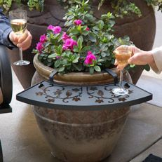 Ledge that hooks onto flower pot for patio end table...great idea!