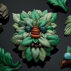 """""""Troldeskoven (In the Troll Wood)"""" is one of the highlights of the Collect Open section of the fair. Danish ceramicist Malene Hartmann Rasmussen'sinstallation features her artworks inspired by pagan legends and mythological creatures such as the Green Man and the Wodewose, mounted against a wallpaper of leaves, Marlene Hartmann Rasmussen"""