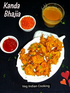 Kanda Bhajia (Onion Fritters) Kanda #Bhajia aka Pyaaz #Pakore aka Onion Fritters is a very popular Indian street food. It is a savory deep fried snack made with sliced onions and gram flour and flavored with Indian spices. It is mainly served as #teatimesnack.  #kandabhaji #pakoda #onionpakora #indianrecipes #indianfood #indiancuisine #foodblogger #vegindiangoodfood #vegindiancooking #easyrecipes #mumbaisteetfood #indianstreetfood