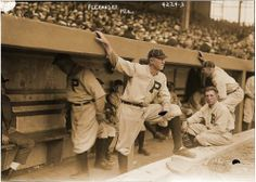 1917. Hall of Fame Pitcher Grover Alexander standing in the Phillies dugout