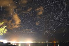 """View of International Space Station from Spanish Island of Majorca Steve: """"That's Puerto Pollensa at the bottom. Two minutes earlier this pass was seen from UK in SW, from Majorca it passed directly in front of Polaris. 19 minutes of 10 sec ISO800 images stacked, used 550D + 14mm f2.8 lens.""""  Credit: Steve Knight Date: June 15, 2015  #ISS #Space #Astronomy #Stars #Earth #Majorca #Mallorca #PuertoPollensa #España #Astrophotography #Art #Science #Timelapse Google+"""