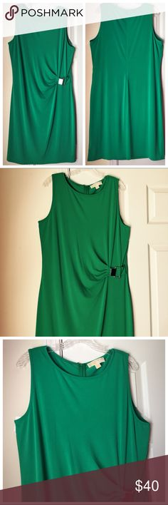 Michael Kors Dress Gorgeous green with a hint of teal, jersey dress by MICHAEL Michael Kors. Silver logo accent at waist. Hidden zipper. Very good condition/no damage or flaws. 39 inches. ✨ LMK if you have questions! 📬Open to reasonable offers 📩 Will drop for discounted shipping MICHAEL Michael Kors Dresses