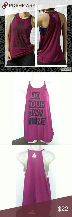 """Reebok Halter Tank Top Purple/berry halter tank top. Size xl. New with tags. Close fit top. Says """"DO YOUR OWN THING """"  in the front and Reebok in small letters on  the back on top. Light comfortable material. 95% rayon 5% spandex. Large arm holes for comfortable west while working out along with longer flattering length. Reebok Tops"""