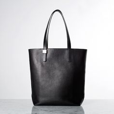 """I now own the Petra Magazine Tote in Black. It is simple, elegant and roomy without overwhelming my 5'1"""" frame. The silver hardware is just enough to give it a bit of chic. I am already eyeing their Twill backpack collection! Too many bags, too little time https://www.everlane.com/collections/petra/products/petra-magazine-black"""