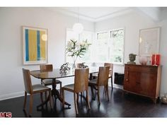 love this dining room. love those chocolate floors.