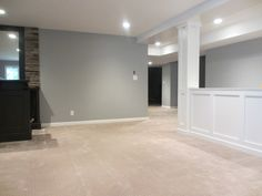 half walls are perfect for basement renovations - keeping space open, while hidi. half walls are p Basement Wall Colors, Gray Basement, Basement Painting, Basement Carpet, Basement Walls, Basement Ideas, Basement Color Schemes, Open Basement, Fabric Room Dividers