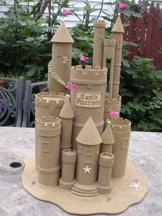 Mostly cardboard, glue, and sand.but you have to put a lot of love into it. Beach Ball Crafts, Kids Parade Floats, Cardboard Box Castle, Sand Castle Cakes, Under The Sea Decorations, Castle Project, 4th Of July Parade, Prom Themes, Happy Birthday Baby