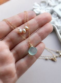 Pearl and Ocean Blue Chalcedony Necklace - Double strand, two strand Necklace - Two Layers - Ocean Blue Chalcedony Briolette, Pearl Trio. $54.00, via Etsy.
