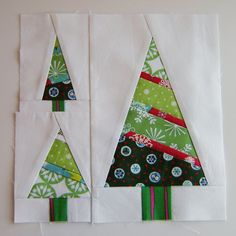 Make 2 medium, 4 small and one large tree assemble into one block.  Make 4 blocks for a wall hanging