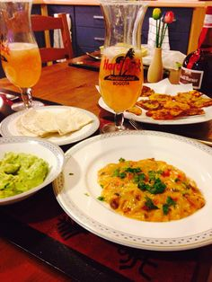 Chorizo with melted cheddar cheese, patacones with guacamole and Blood Orange Margarita!
