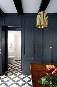 Jesse DeSanti -Floor tiles-Dark doors- -Brass pendants
