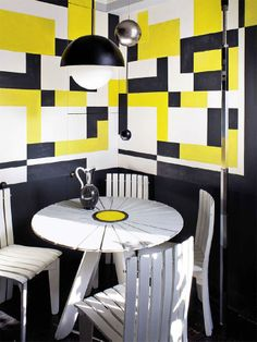 Geometric wall by Florence Lopez. This is such a fun sitting area. I don't know where this would work best in a home, but it is really cool. http://gainesville.bosshardtrealty.com/realtors/danielaasved @danyaelaasved