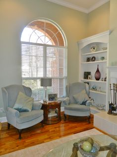 Beautiful family room off the main foyer with fireplace, built-in shelves, & arched window. Gorgeous 4/4, all-brick home for sale in Ox Bottom Manor in Tallahassee, Florida! 239 Thornberg Drive. Check out our blog for the Virtual Tour!