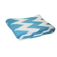Recycled cotton-blend throw with chevron motif. Made in the USA.    Product: ThrowConstruction Material:  Recycled cotton and  acrylic   Color: Cerulean  Features:Zigzag patternEco-friendlyCreated from pre-consumer fibers and clippings that are collected after the cut and sew process Made in the USA  Dimensions: 50 x 60     Cleaning and Care: Machine wash and dry on low