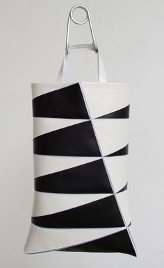 FRRRY, POLYGON SERIES DECAGON BAG: completely unreal. this folds, with all the black triangles inside, into a decagon.