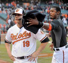 Adam Jones sneaks up behind Chris Davis to deliver the congratulatory shaving-cream pie after the Orioles' home opener.
