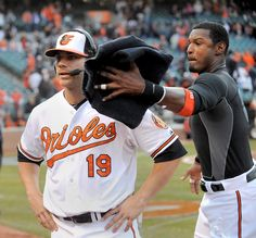 Chris Davis takes a pie to the face from Adam Jones during a TV interview after the Orioles beat the Twins in the 2013 home opener.