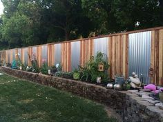 15 privacy fences that will turn your yard into a secluded oasis, curb appeal, fences. Accent an ordinary fence with sheet metal. Privacy Fence Landscaping, Privacy Fence Designs, Backyard Privacy, Privacy Fences, Backyard Fences, Backyard Landscaping, Landscaping Ideas, Backyard Ideas, Diy Fence