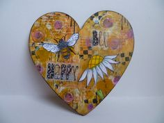 Mixed media altered heart with Stampotique