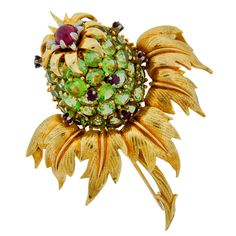 1stdibs.com | TIFFANY / SCHLUMBERGER Peridot Ruby & Yellow Gold Thistle Brooch, 1980