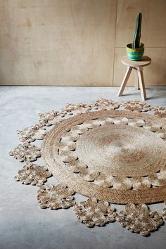 Intricately hand crafted rug will bring a touch of warmth and personality to any space. Made by individual artisans using hemp fibers and age-old traditions.