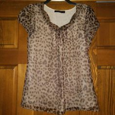 The Limited leopard print top Shell & lining: 100 % polyester, & made in China. Shimmery look (see 2nd pic) The Limited Tops Blouses