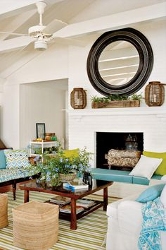 Trick of the Trade - Casual Chic Lake House - Southernliving. Add furniture or accessories that can double as extra seating to accommodate a crowd. Meg outfitted the deep fireplace hearth with custom cushions and added portable woven cubes for seating in a pinch.     Source Guide Pillow, dining chair cushion, and bench cushion and pillow fabric: Alan Campbell's Cap Ferrat (AC103-21); quadrillefabrics.com.