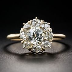 .78 Carat Center Diamond Antique Cluster Ring Unique. I also like how it is yellow gold.