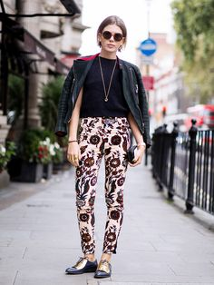 Printed pants + a basic black tee + over-the-shoulders moto jacket + metallic flats