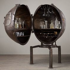 Dating to the 1920s, a former light bulb-testing machine has been ingeniously repurposed as a bar cart to shelter spirits, wine bottles and hanging glassware. The original, nearly a century old, was salvaged from a factory in Germany. Crafted of iron, a hinged segment opens to grant access to bottles and barware, while the small hatch opens, too.