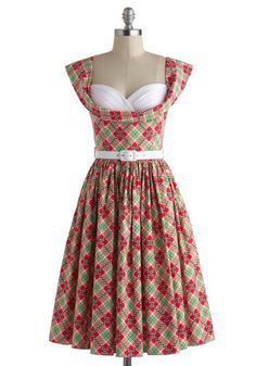 A 50s inspired #vintage #dress with a cheerful print and sexy neckline is my idea of heaven.