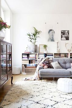 Perfect couch! ETC INSPIRATION BLOG DESIGN INTERIOR HOME STOCKHOLM SWEDISH FRESH BRIGHT LIVING ROOM AMELIA WIDELL VIA THE LOVELY LIFE GREY BLUE SOFA DIAMOND SHAGGY MOROCCAN RUG LOW WHITE SHELVES SPOTTED BLACK WHITE THROW PILLOW WHITE POUF FLOOR SEAT photo ETCINSPIRATIONBLOGDESIGNINTERIORHOMESTOLKHOLMSWEDISHFRESHBRIGHTLIVINGROOMAMELIAWIDELLVIATHELOVELYLIFE.jpg