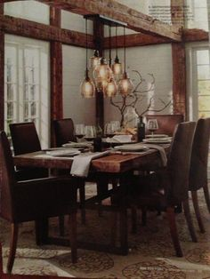 Love the wood beams & the dining room lights hanging from them!!