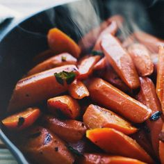 Sautéed Carrots with Lemon and Marjoram | Food & Wine ( This is a great dish! I steamed them a little,  after the first step of sauteing,  then in place of refine sugar I used clover honey!  They ate them up.)