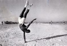 James Albany does a one-handed hand stand as a rite of Spring at Tybee on March 22, 1982. (Savannah Morning News)