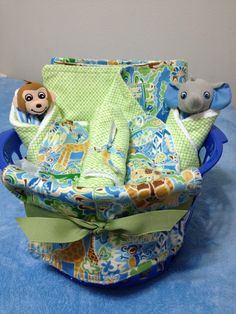 Cute gifts for baby!: baby baskets with burper rags, bibs, and towels. Super cute stuff-- made by my mom :)