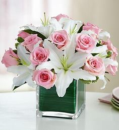 Pave Floral Arrangement  with flowers close together, roses and white lilies