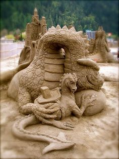 I always love sand sculptures.  These are awesome!