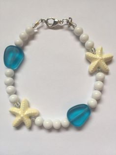 A personal favorite from my Etsy shop https://www.etsy.com/listing/278587406/starfish-seaglass-beach-glass-blue-white