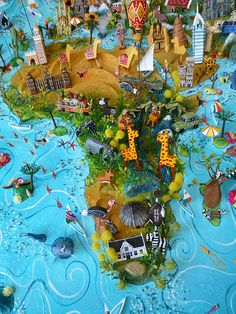 Sara Drake - Africa detail from large 3D world map. Maps are made from mixed media, including papier mache, balsa wood, acrylic paint, beads and wire. All details are hand made and to commission. Each map is personalised with the details of the client's own travels.