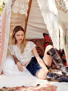 This Free People crochet top isn't terribly interesting, but I was really drawn to the crochet blanket fort they've made for the model here!